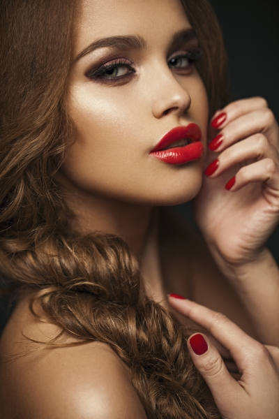 8737044-sexy-beauty-girl-with-red-lips-and-nails-provocative-make-up-luxury-woman-with-blue-eyes-gorgeous-woman-face-long-hair